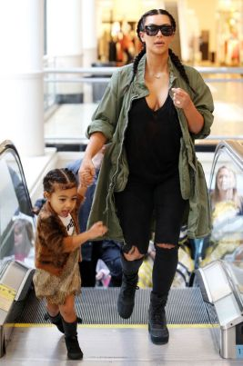 Kim-Kardashian-and-Kanye-West-with-daughter-North