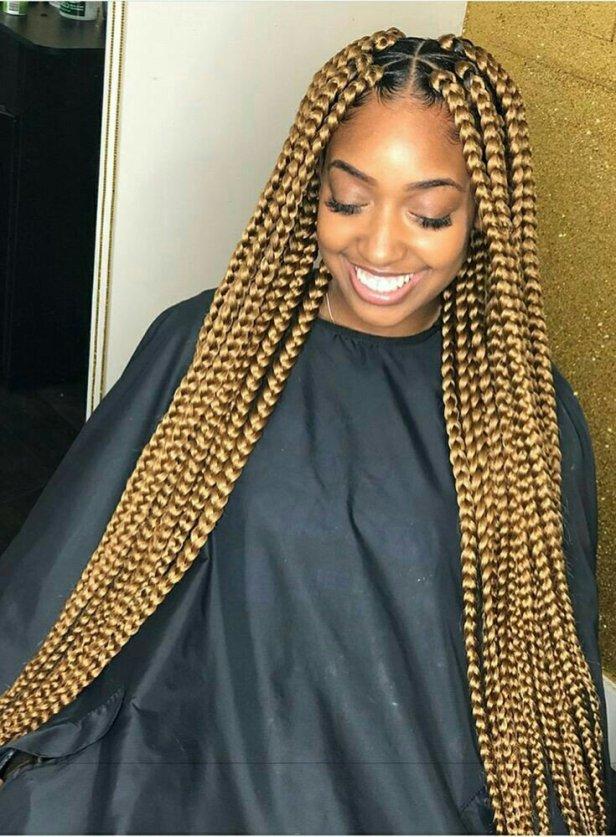 Blonde braids on dark skin
